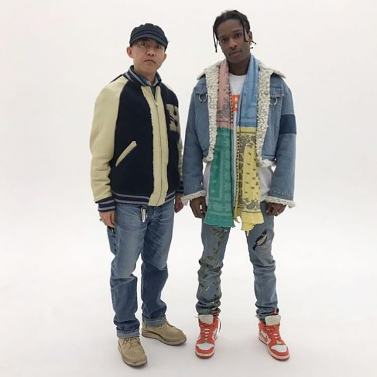 ASAP Rocky pairs sherpa denim jacket with embroidered jeans with the Supreme x Nike SB Dunk High.