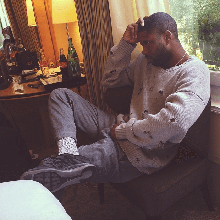 ASAP Twelvyy dresses up the Supreme x Nike Flyknit Lunar1+ with trousers and a textured sweater.