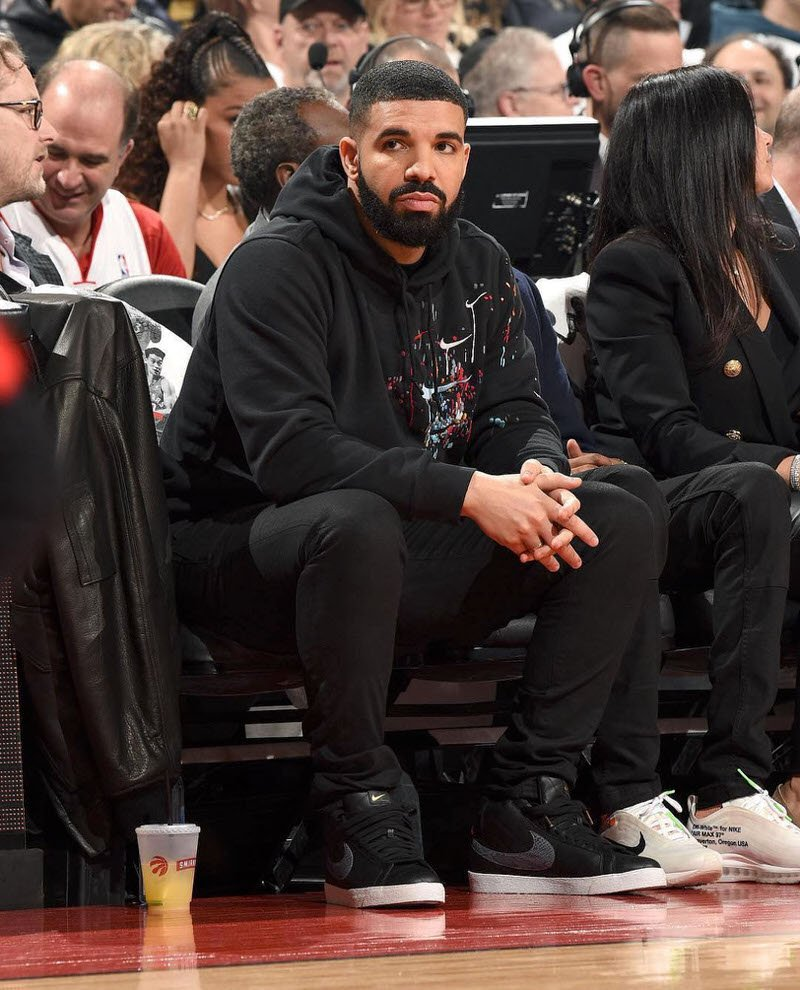 Drake wears graphic Nike sweatshirt and skinny jeans with the Supreme x Nike SB Blazer (photo by Ron Turenne).