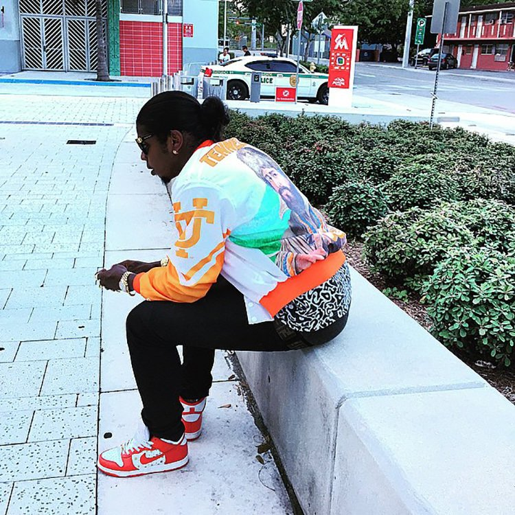Trinidad James wears the Supreme x Nike SB Dunk High with University of Tennessee warm-up jacket.