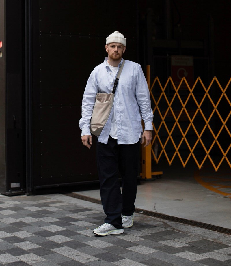 @olvh pairs wide-legged trousers and an unbutton shirt with a tee layered underneath with his Zoom Fly SPs.