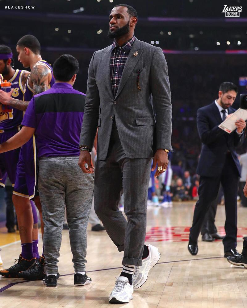 LeBron James wears the A-COLD-WALL x Nike Zoom Vomero 5s with a Thom Browne suit.