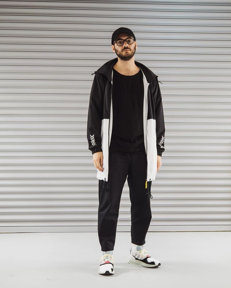 @ozakon keeps his wardrobe palette neutral and emphasizes the technical trend with a contemporary rain jacket and adidas 4D Futurecrafts.