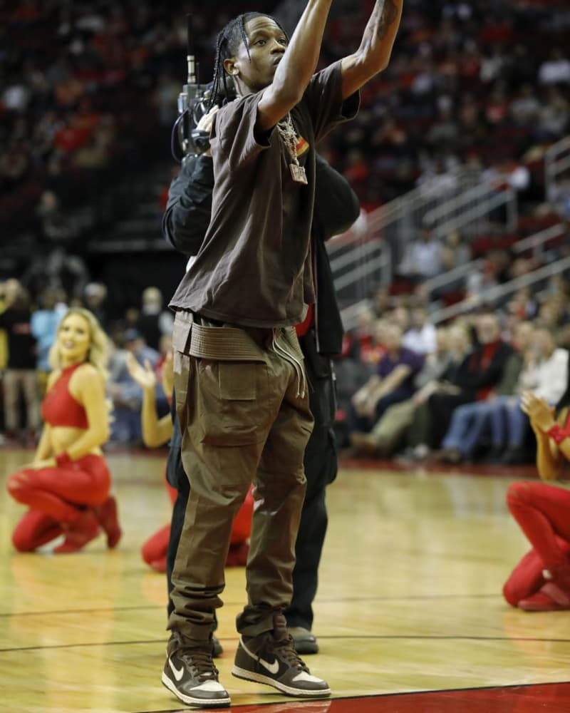 Travis Scott pairs neutral tones with cargo pants and the Easter SB Dunk Highs.