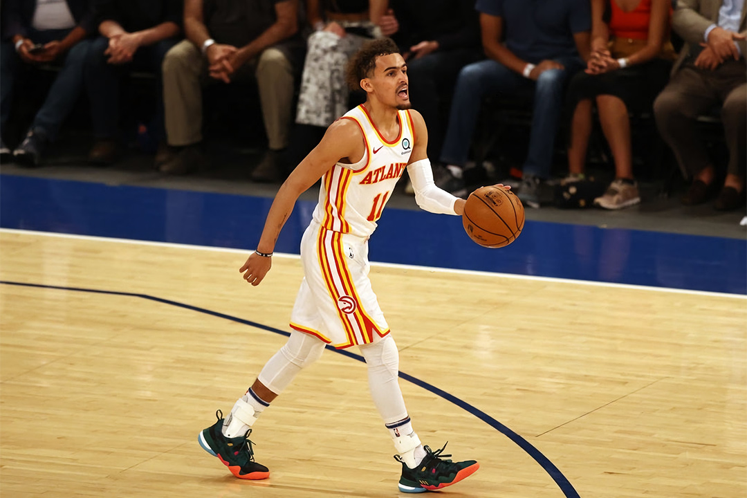 Trae Young in the Adidas Trae Young 1. Colorway inspired by the 1996 Olympics.